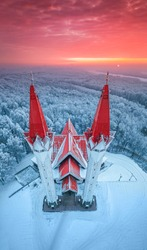 Aerial drone view of the famous landmark of Ufa and Bashkortostan - Lala Tulpan mosque during sunset in winter season. Islamic religion and muslim worship in Russia concept
