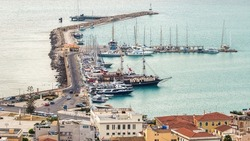 Aerial drone view of the Ionian Sea port of Zakynthos, Greece. Port with moored boats, embankment street, buildings