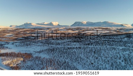 Aerial drone view of the Lapporten mountains, near Abisko national park, sunset, sunny winter evening, Kiruna, Norrland, Lappland, Sweden Stock foto ©