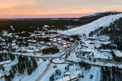 Aerial drone view of the Levi ski village, colorful dusk, in Lapland, Finland
