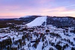 Aerial drone view of the Levi ski village, winter evening sunset, in Lapland