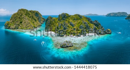 Aerial drone view of tropical Shimizu Island steep rocks and white sand beach in blue water El Nido, Palawan, Philippines. Tourist attraction most beautiful famous nature spot Marine Reserve Park Сток-фото ©