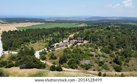 Aerial drone view of wooden Alçitepe terrace of observation Baki Terasi watch point of whole Gallipoli Peninsula of Dardanelles with blue sky and green fields