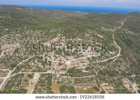 Aerial drone view of Zena Glava village near Tito's Cave on Vis Island with view of adriatic coastline Stock fotó ©