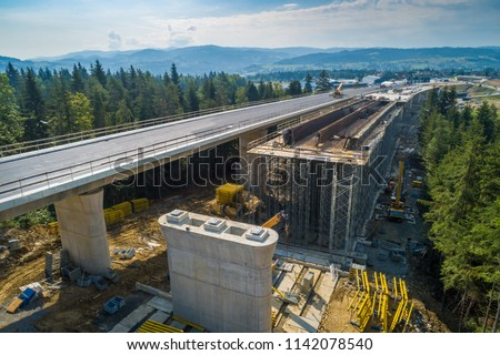 Aerial drone view on highway road under construction. Construction of the viaduct on the national road number 7 in Poland