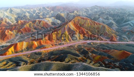 Aerial drone view on most colorful mountain on earth, and the most vivid one within the Zhangye Danxia National Geological Park. Multicolored slopes covered by striped pattern, a unique landscape. Stock fotó ©