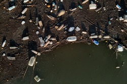Aerial drone view waterfront scrap-heap plastic bottles rubbish pollution marine debris outdoors, environmental ecological natural disaster caused by human activity, ecosystems terrible state concept