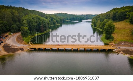 Photo of  Aerial Dubingiai bridge across lake Asveja by drone