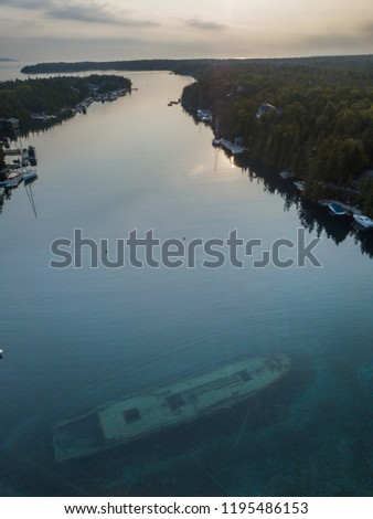Aerial during Sunrise of the Canadian Schooner Ship Sweepstakes sunken ship wreck in Tobermory in the Fathom Five National Marine Parkand is a historic sight 1867 and popular among divers and tourism