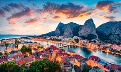 Aerial evening cityscape of old croatian resort - Omis town. Fantastic summer seascape of Adriatic sea, Dalmatia coast, Croatia, Europe. Beautiful world of Mediterranean countries.