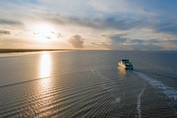 Aerial from the ferry from Ameland arriving at Holwerd in the Netherlands at sunset