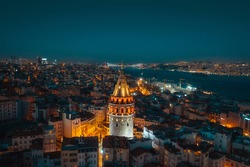 aerial galata tower and istanbul bosphorus in evening blue hour
