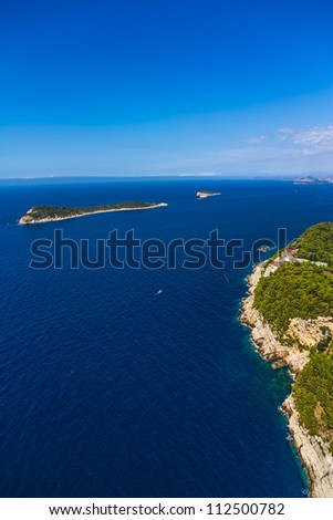 Aerial helicopter shoot of Adriatc landscape with two islands - Dubrovnik archipelago, Croatia.