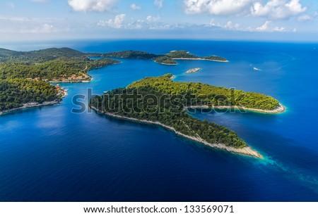 Aerial helicopter shoot of National park on island Mljet, village Pomena, Dubrovnik archipelago, Croatia. The oldest pine forest in Europe preserved.