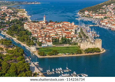 Aerial helicopter shoot of Trogir old town panorama with Kamerlengo Castle in front. Croatian tourist destination.
