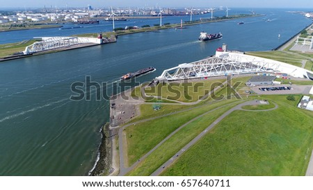 Aerial high altitude of Maeslantkering showing large ships sailing through barrier this storm surge barrier is part of Delta Works #657640711