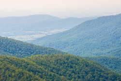 Aerial high angle view of Shenandoah Blue Ridge appalachian mountains, rolling hills from skyline drive overlook in Virginia with Stanley city rural village town