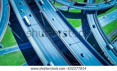 Aerial highway junction. Busy highway from aerial view. Highway shape like number 8 and infinity sign. Urban highway and lifestyle concept. #632377814