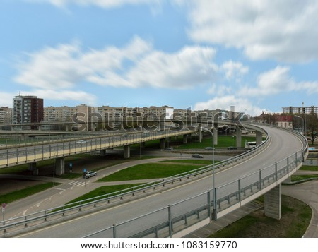 Aerial highway junction. Highway from aerial view. Urban highway and lifestyle concept. Construction of additional concrete road curve of viaduct in Riga, Latvia #1083159770