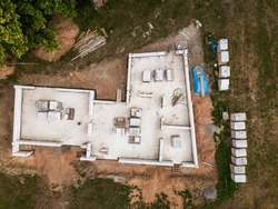 Aerial image of a new family house being built. New private housing development construction in rural countryside aerial view.