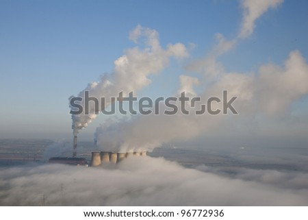 Aerial image of a Power Station on a misty morning. - stock photo