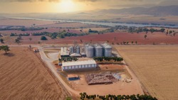 Aerial image of factories with grain storage silos. Aeration and export storage.