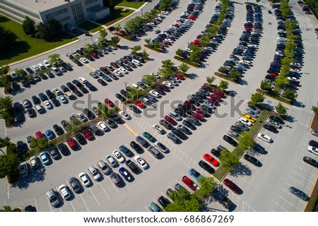 Aerial image of hundreds of cars in a parking lot #686867269