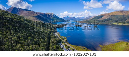 aerial image of loch linnhe in summer near duror and ballachulish and glencoe in the argyll region of the highlands of scotland showing blue water and green fertile coast line Foto stock ©