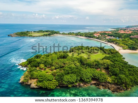 Aerial image of Nusa Dua Beach in Bali Indonesia with two surrounding peninsulas  taken above from the sea during April with drone  #1369394978