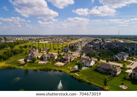 Aerial image of single family homes in Bettendorf Iowa USA #704673019