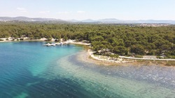 Aerial image of St. Ante walkway, located in the dense pine forest on the shore of Adriatic sea at the city of Sibenik, Croatia