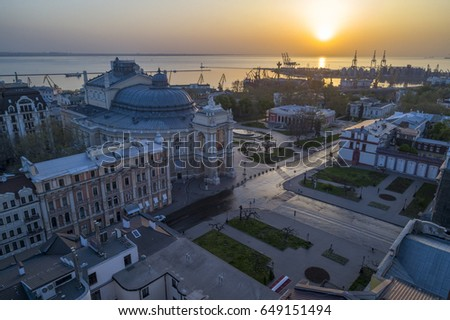 Aerial image of sunrise over the Odessa Opera House Ukraine. The port of Odessa is in the background #649151494