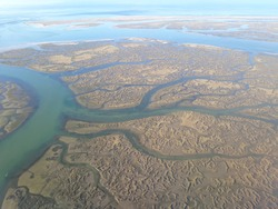 Aerial image of the lagoon of Ria Formosa nature park near Faro, Portugal.