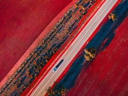 Aerial image of the road in Western Australian Golden outback.The soil is red as it is rich in iron ore.
