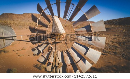 Aerial image over an old windmill / windpump / windpomp in the karoo region of south africa