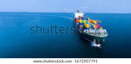 Aerial in front of cargo ship carrying container and running for export  goods  from  cargo yard port to custom ocean concept freight shipping by ship . Zdjęcia stock ©