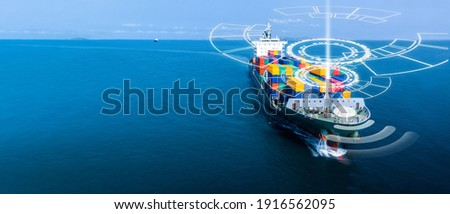 Aerial in front of cargo ship with smart circle line technology and WIFI technology , large ship carrying container and running for export  goods  from  cargo yard port to custom .