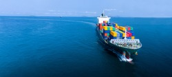 Aerial infront of cargo ship carrying container and running for export  goods  from  cargo yard port to custom ocean concept freight shipping by ship .