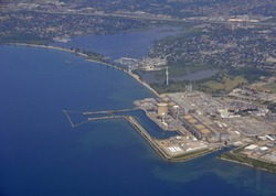 aerial lake shore landscape, view of a nuclear power plant located on the shore of Lake Ontario, Pickering Ontario Canada