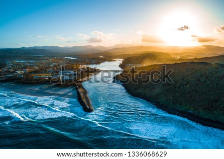 Aerial landscape of Tallebudgera river and Palm Beach suburb at sunset. Gold Coast, Queensland, Australia #1336068629