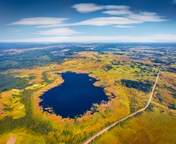 Aerial landscape photography. Aerial view in the shape of heart of Bile Lake. Attractive morning scene of Shatsky National Park, Volyn region, Ukraine, Europe. Beauty of nature concept background.