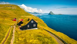 Aerial landscape photography. Amazing morning view from flying drone of Velbastadur village with typical turf-top houses. Adorable morning scene of Streymoy island, Faroe, Denmark, Europe.