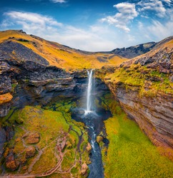 Aerial landscape photography. Awesome summer view from flyind drone of Kvernufoss watterfall. Superb morning scene of pure water river in Iceland, Europe. Beauty of nature concept background.