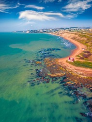 Aerial landscape photography. Sunny spring view from flying drone of Giallonardo Beach. Spectacular morning seascape of Mediterranean sea, Sicily, Italy, Europe. Traveling concept background.