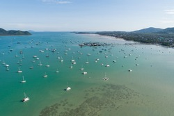 Aerial landscape Seascape Chalong pier with sailboats Yacht boats and ravel boats in the sea Amazing view travel image by Drone flying shot Top down view