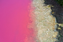 Aerial landscape view of Hutt Lagoon pink lake at Port Gregory in Western Australia.