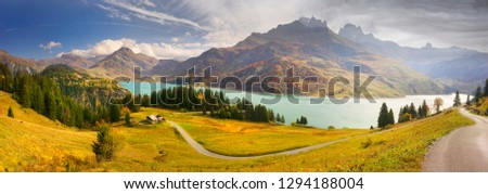 Aerial morning view of Roselend lake/Lac de Roselend. Picturesque autumn scene of Auvergne-Rhone-Alpes, France, Europe. Beauty of nature concept background. #1294188004