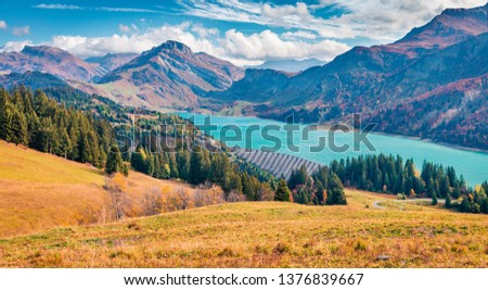 Aerial morning view of Roselend lake/Lac de Roselend. Splendid autumn scene of Auvergne-Rhone-Alpes, France, Europe. Beauty of nature concept background. #1376839667