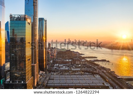 Aerial New York City waterfront skyline at sunset viewed from Hudson Yards towards Jersey City accross Hudson River. #1264822294