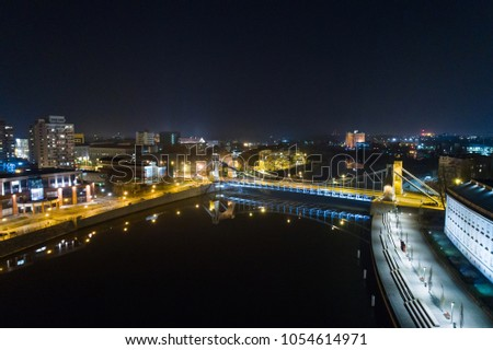 Aerial night drone view on Grunwald Bridge over Odre river in Wroclaw. Breslau, Lower Silesia, Poland #1054614971